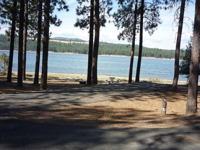 Site #2 Back in site, paved with trees and lake in the background.