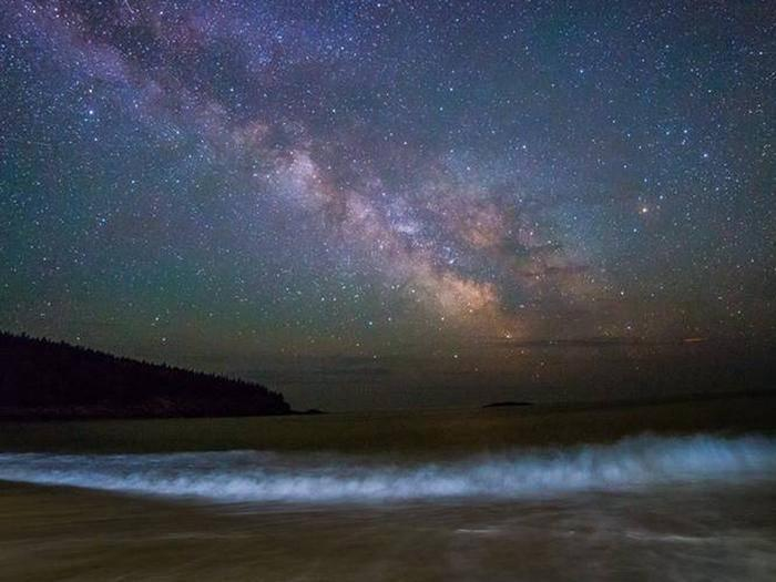 Milky Way over an ocean beachThe Milky Way over the Atlantic Ocean in Acadia National Park