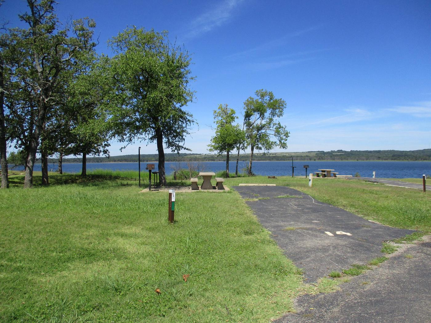 Site 14 - WildwoodSite 14 is a back- in site with easy access to the boat ramp and courtesy dock.  The site also offers a nice lake view.
