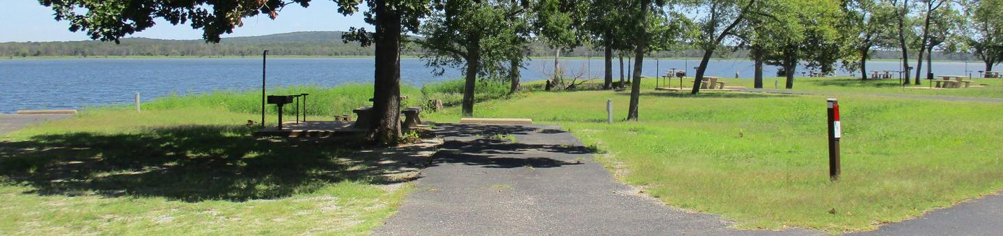 Site 18 - WildwoodThe picnic area on site 18 is mostly shaded and offers a great lake view.