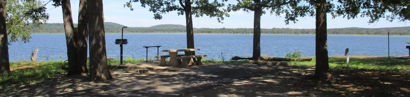 Site 20 - WildwoodSite 20 offers a fully shaded campsite with a great lake view.