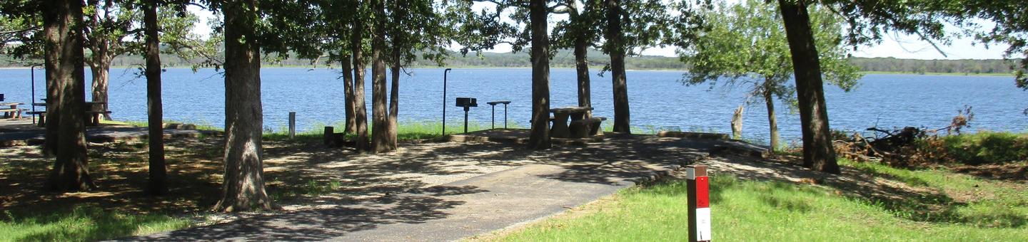 Site 22 - WildwoodSite 22 is a mostly shaded back in site with a great lake view.