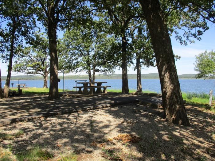 Site 22 - WildwoodSite offers a concrete picnic table, pedestal grill, utility table, lantern holder and fire ring.