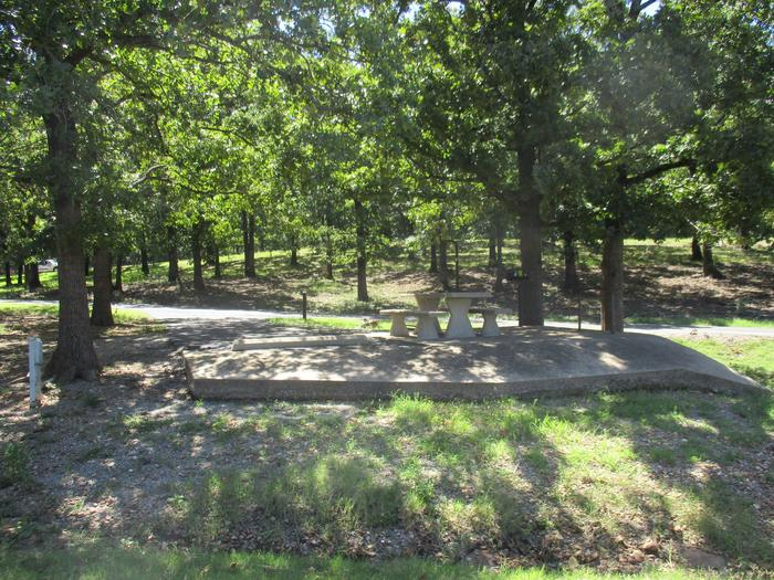 Wildwood - Site 28Terrain around site 28 slopes towards the drainage ditch.  Large concrete apron surrounds picnic table area.  It's a perfect canvas for sidewalk chalk.