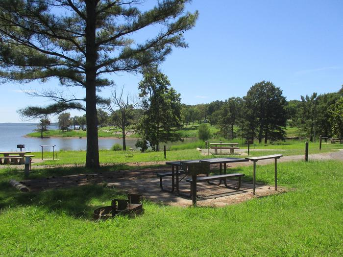 Site 15 - Taylor FerrySite 15 offers a metal picnic table, pedestal grill, utility table and fire ring.