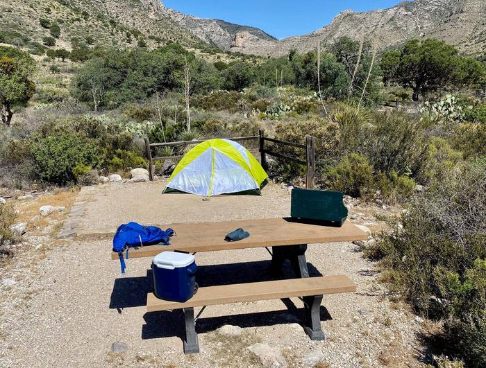 Tent campsite number four, shown with 2-person tent on tent pad.Tent campsite number four with 2-person tent shown.
