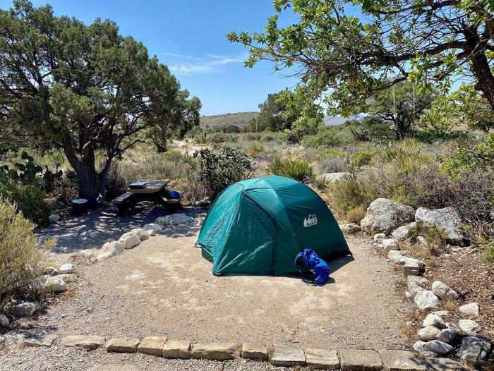 Tent campsite number 6, shown with a two/plus person tent.  This site has a shade tree near picnic table.