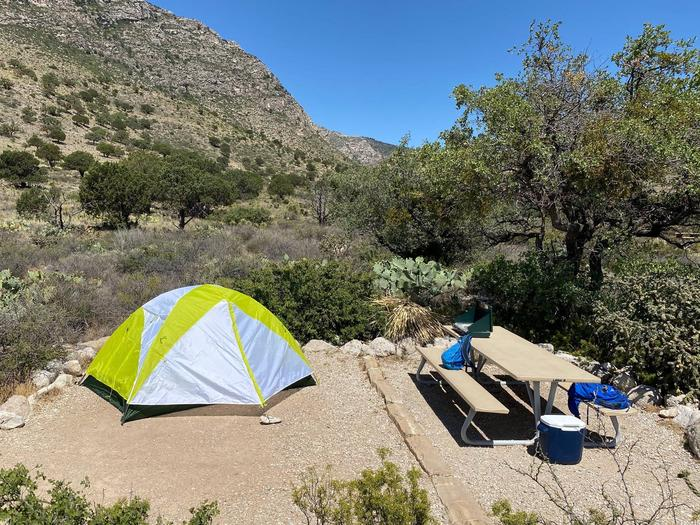 Tent campsite number 7, shown with two-person tent on site and mountain views in the background.