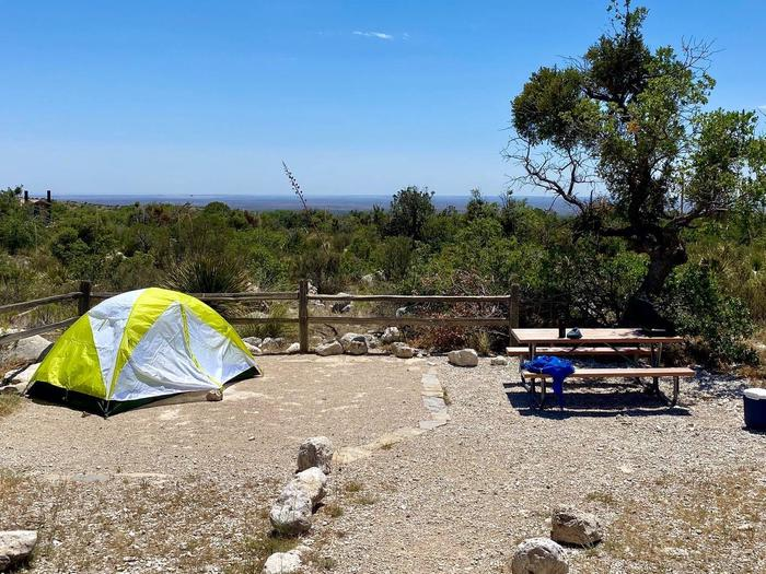 Tent campsite number 10, displaying a two-person size tent with the Permian Basin in the background.
