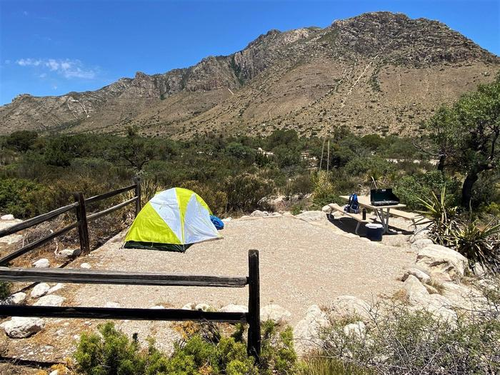 Tent site number 11 with Hunter Peak shown in background.  A two-person tent shown on the tent pad.