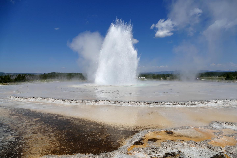 Great Fountain GeyserGreat Fountain Geyser erupts against a blue summer sky