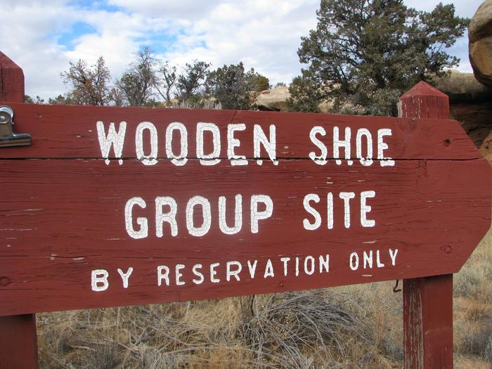 Wooden shoe group site sign.
