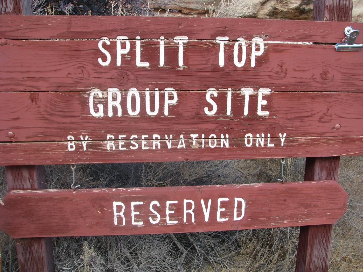 Split top group site sign.