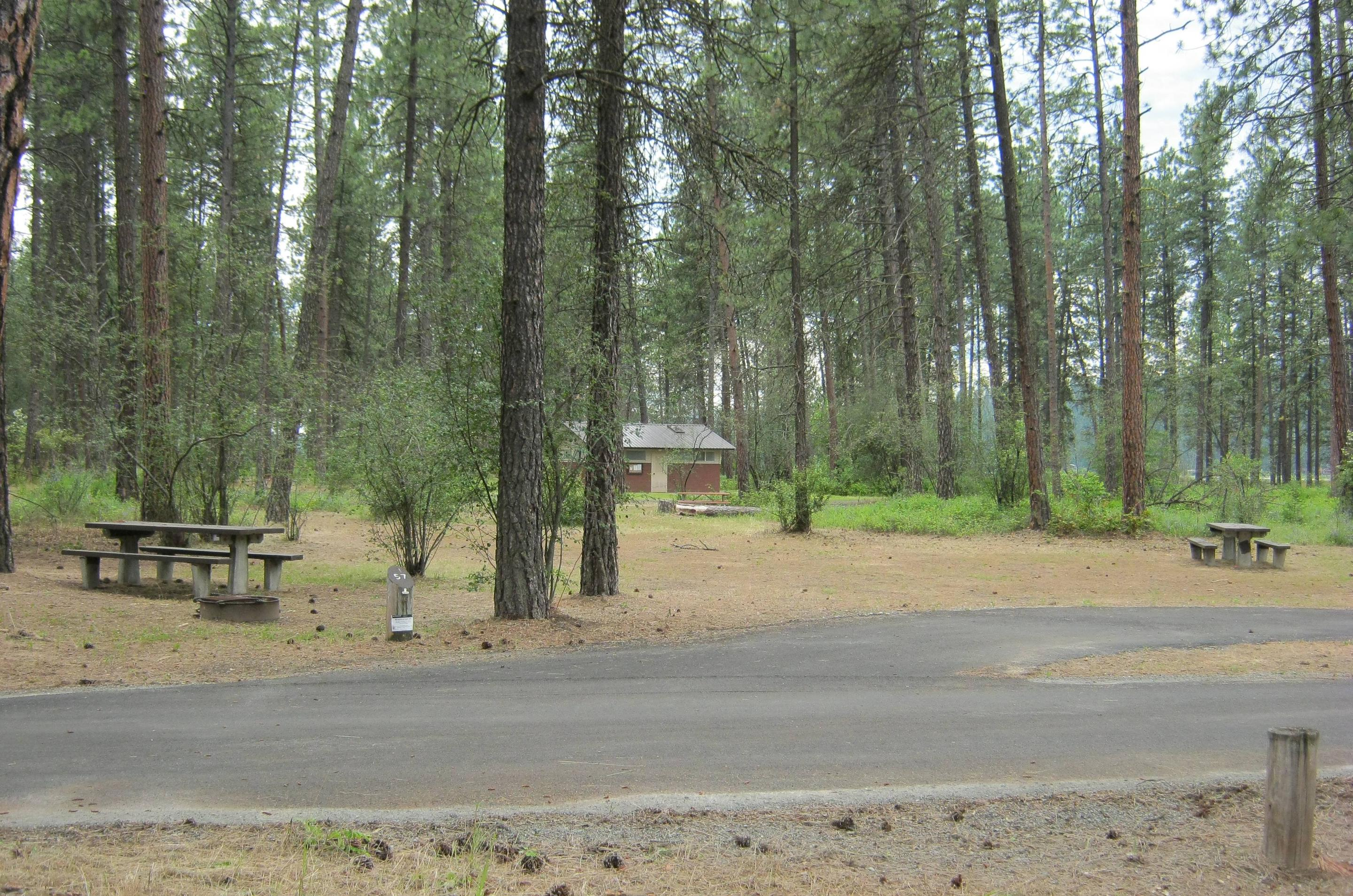 Site 57Site 57, Pull through, Trees and Comfort station in background