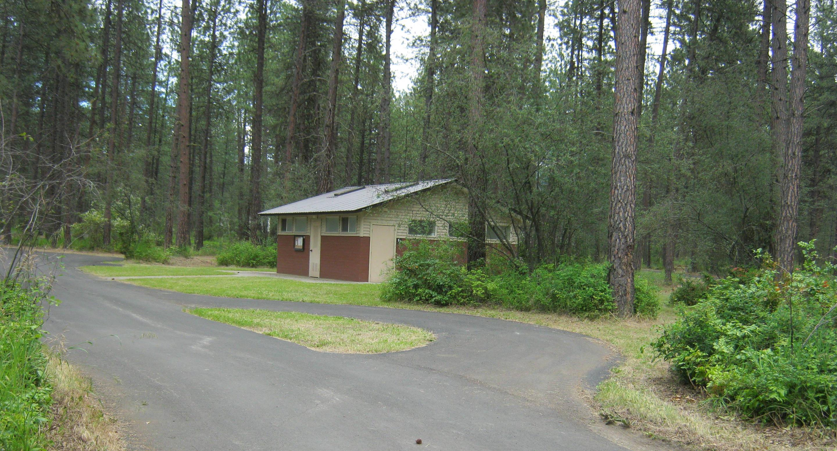 Alt view of 69Site 69, Pull Through, Trees and comfort station in backgorund