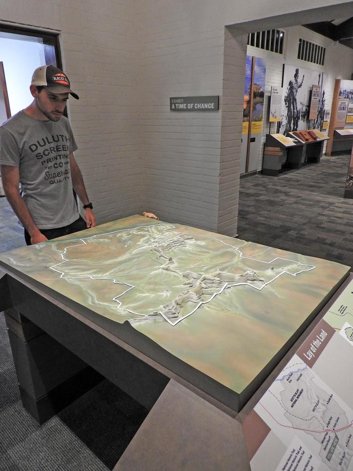 A Visitor Explores the Three-dimensional Map of the MonumentThe newly remodeled visitor center includes a 3-D map of Scotts Bluff National Monument.
