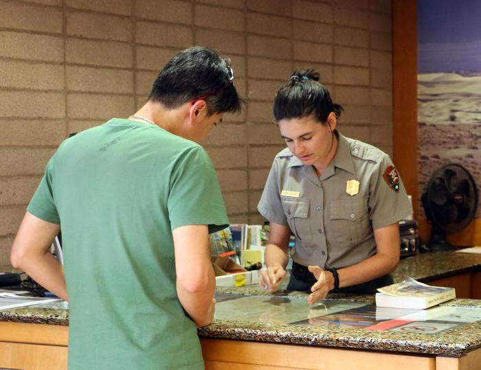Furnace Creek Visitor Center DeskRangers are available to answer questions and help you plan your visit.