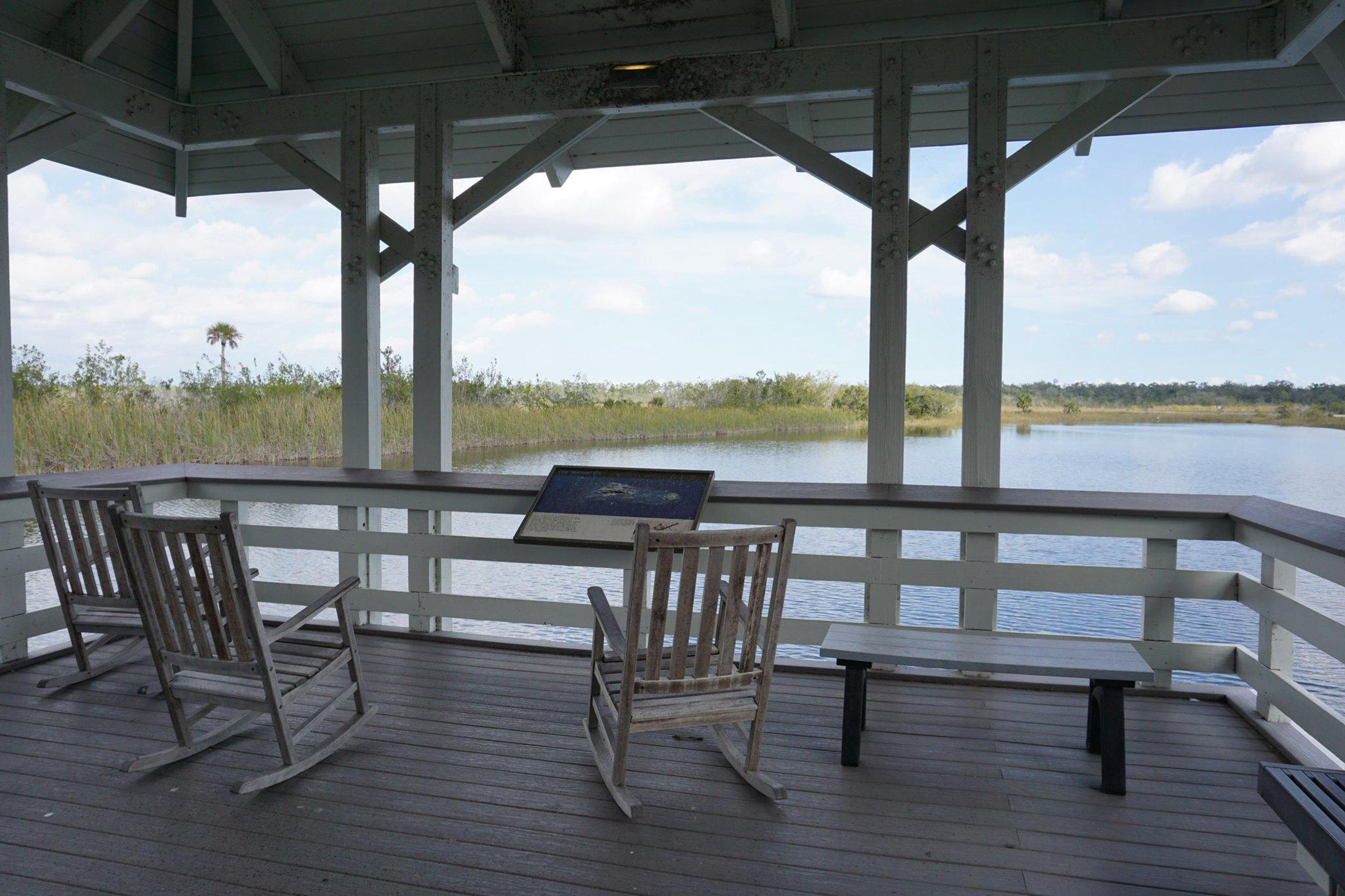 Ernest Coe Rocking ChairsRocking chairs overlook a small lake in back of the Ernest Coe Visitor Center