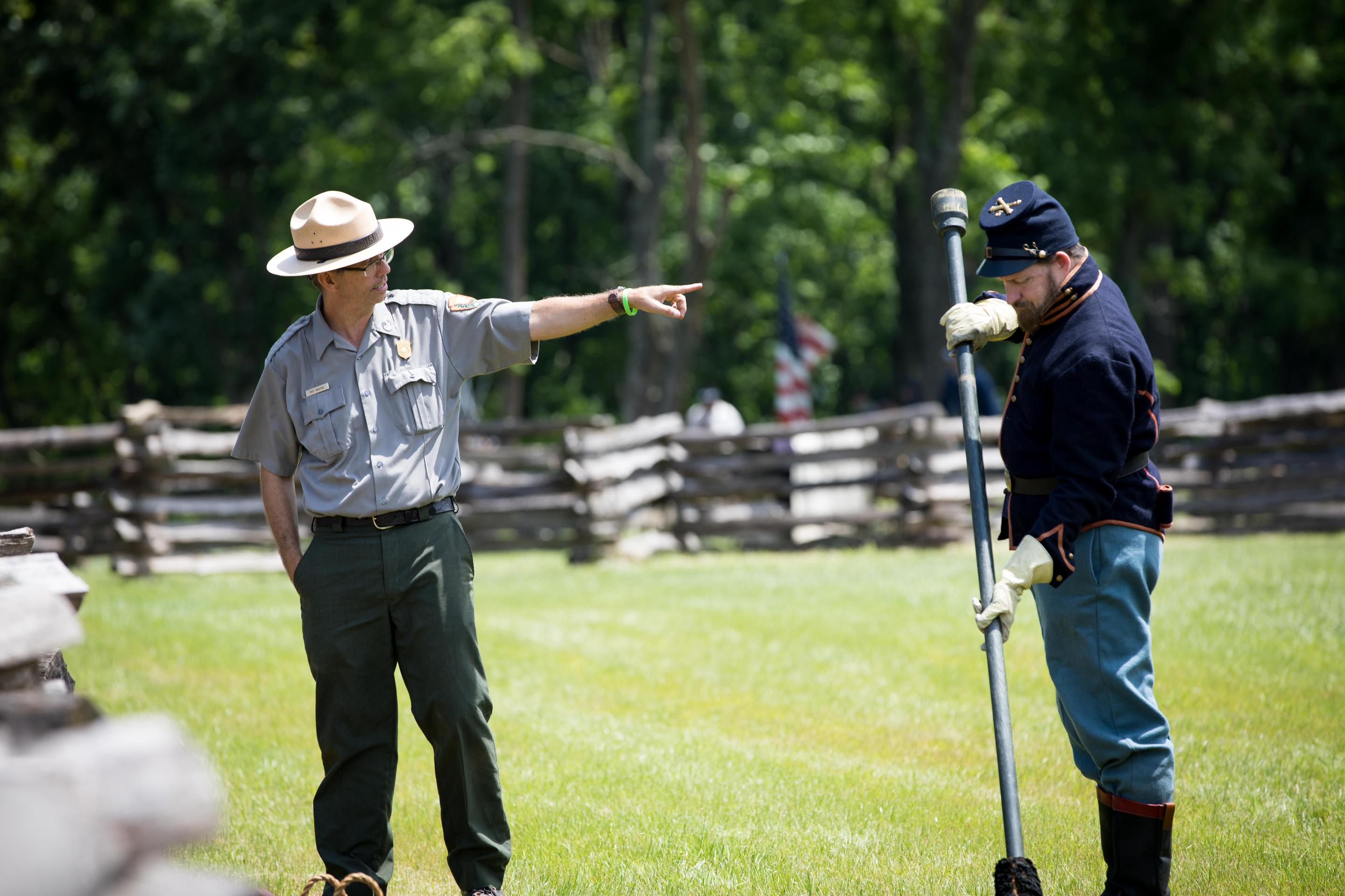 Park Ranger and Cannon CrewRanger Troy Banzhaf giving information about 6 lb. cannon and cannon crew.