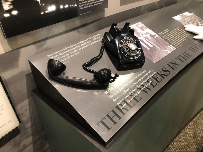 """Visitor Center exhibitsa 1950s telephone sits on an exhibit entitled """"Three Weeks in the World"""""""