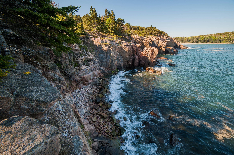 Steep rocky cliffs along shore