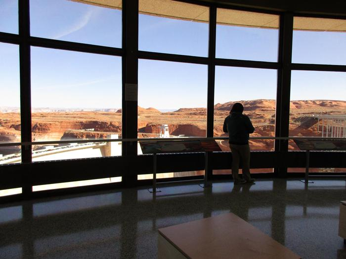 Carl Hayden Visitor Center Rotunda WindowsFrom the rotunda windows you can view Glen Canyon Dam and Lake Powell on your left, and Glen Canyon Bridge and the Colorado River on your right. Look down to see the powerplant.