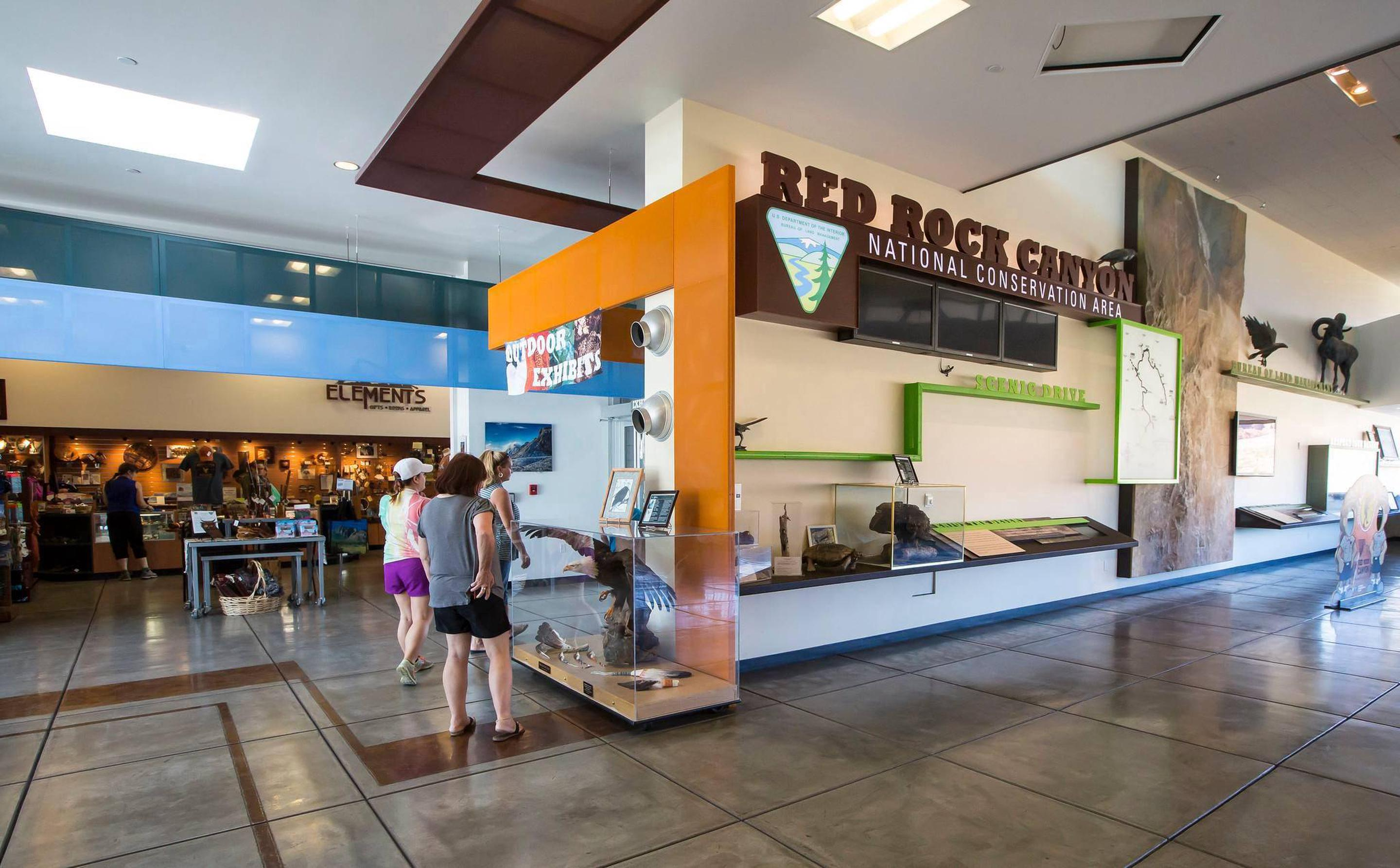 Visitors explore exhibits at the Red Rock Canyon National Conservation Area Visitor Center. Visitors view exhibits at the Visitor Center.