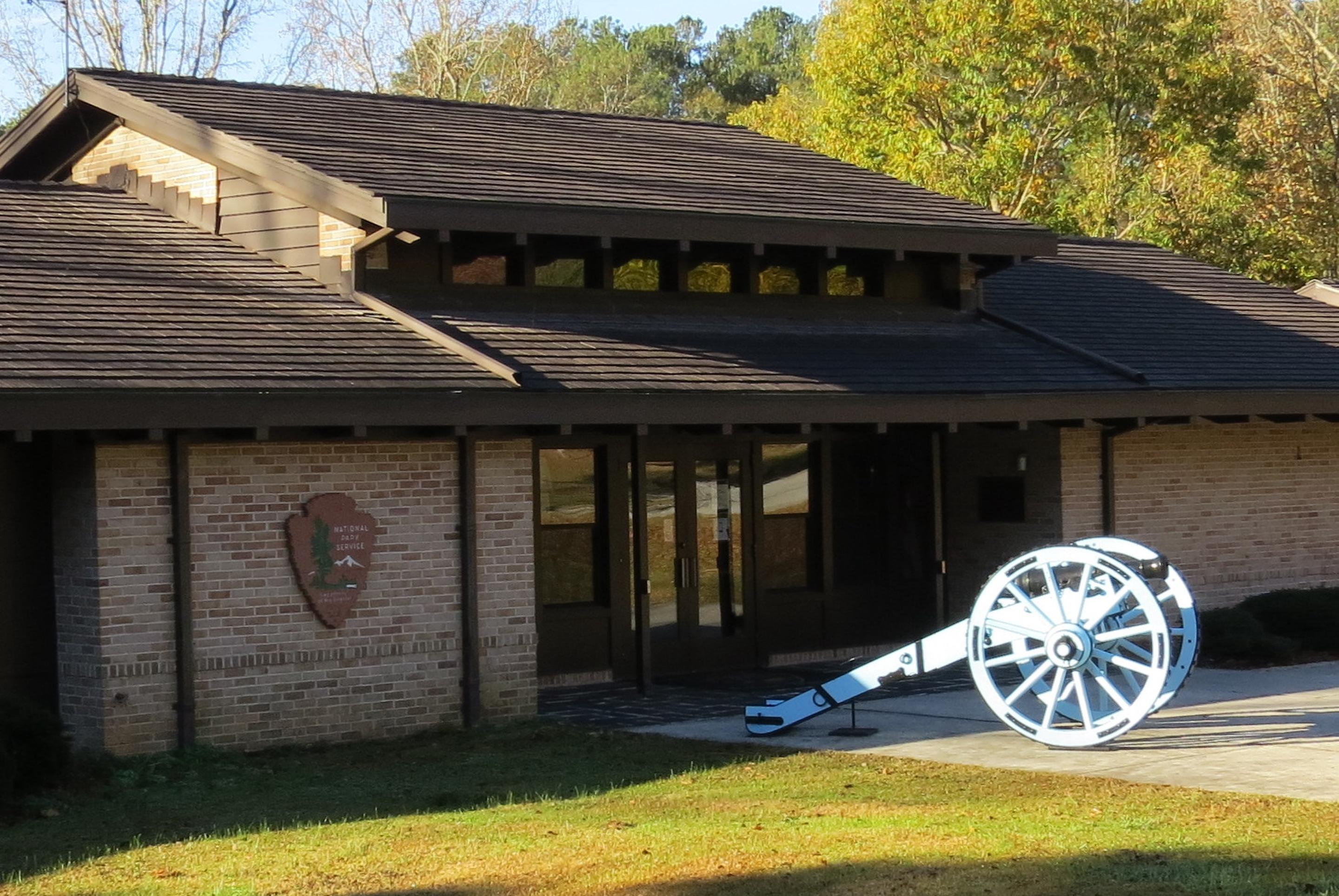 Visitor CenterThe Horseshoe Bend NMP's Mission 66 Visitor Center with 1812 era 3-pounder cannon.
