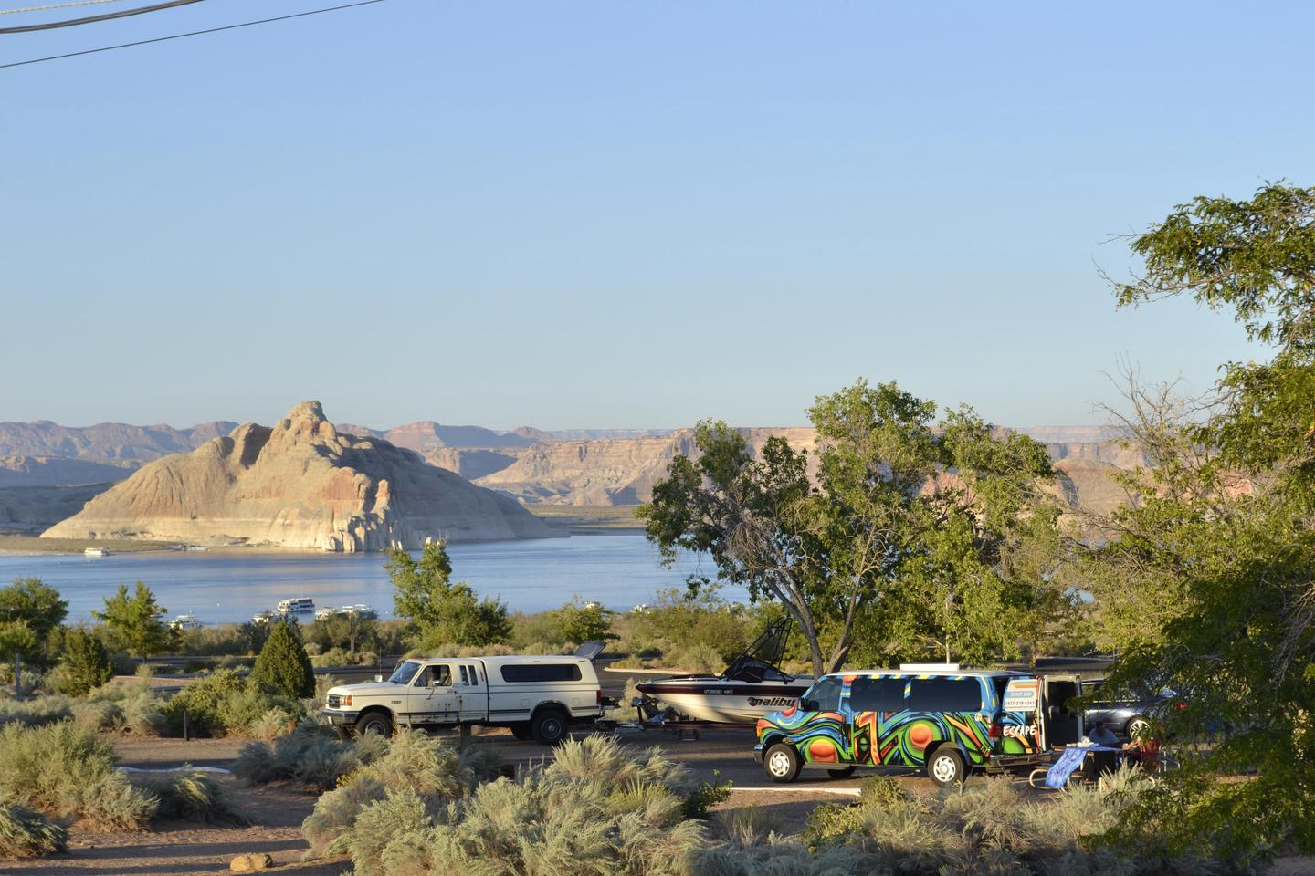 Different vehicles at Wahweap campground.There's room to pull your boat into your camping spot.