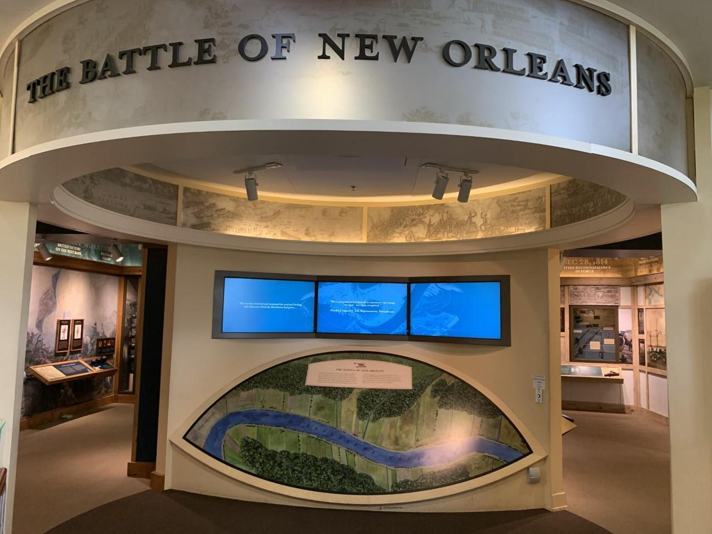 Entrance to Exhibits in Visitor CenterAn American cannon sits at the rampart overlooking the battlefield.
