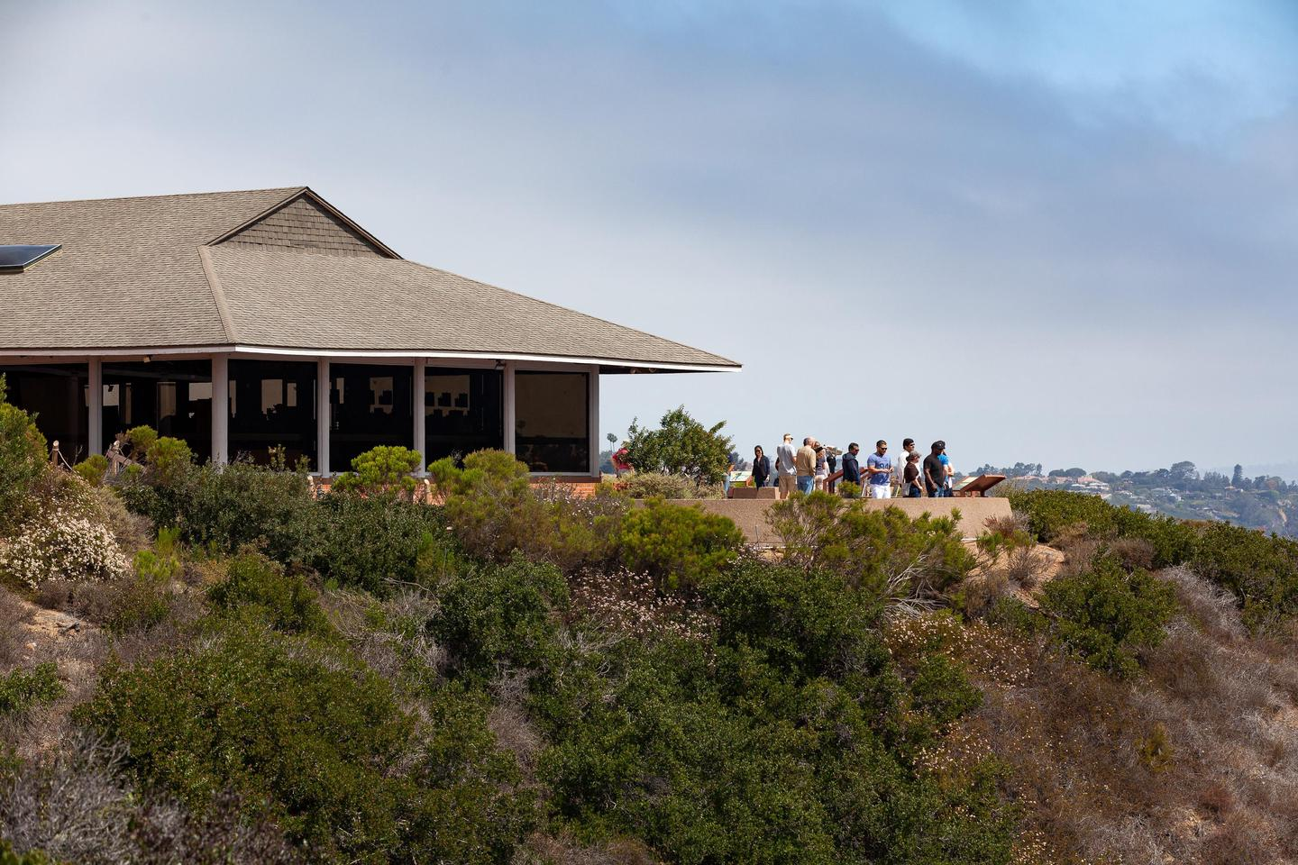 View Building looking to the northThe View Building at the Visitor Center with people at the scenic overlook over San Diego Bay.