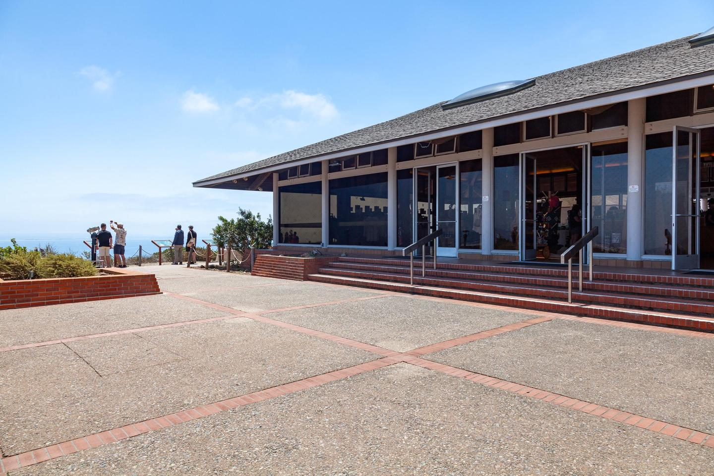 Back entrance to the View Building.The patio at the rear of the View Building. Telescopes are present as well as a view of Ballast Point from this spot.