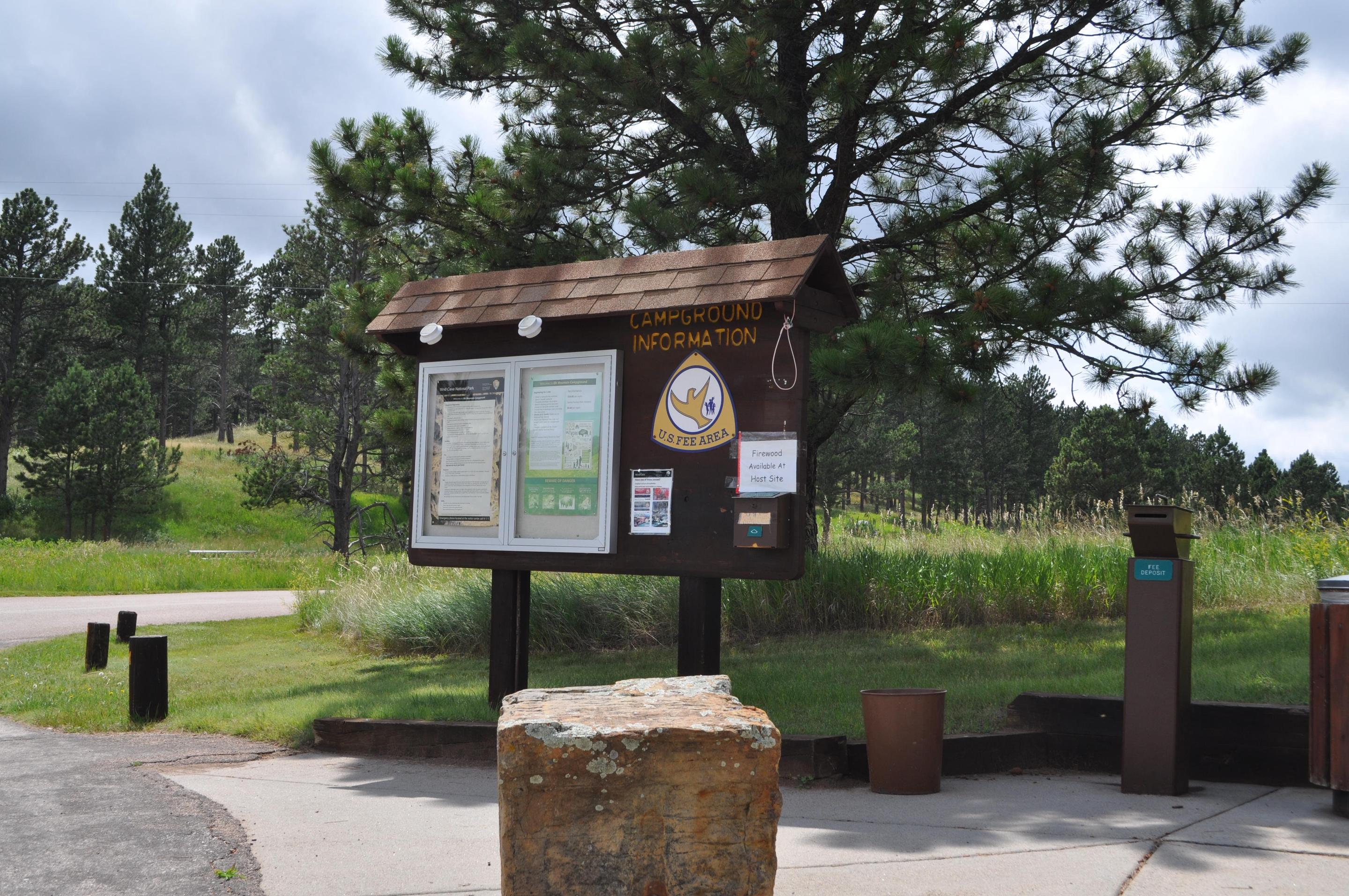 Elk Mountain Campground Registration BoardThe Elk Mountain Campground is a first-come, first-served site. Campers can register the campsite of their choice the day of their stay, and drop their cash payment in the drop box.