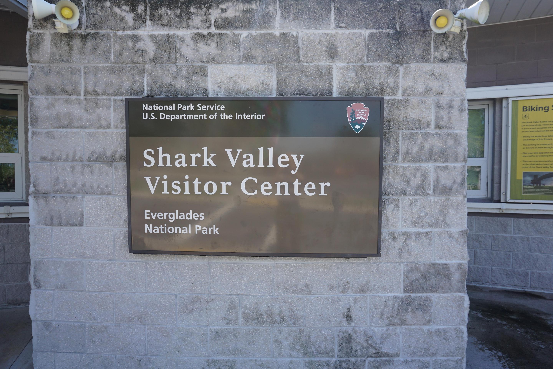 Shark Valley Visitor Center SignSign hanging outside of the Shark Valley Visitor Center