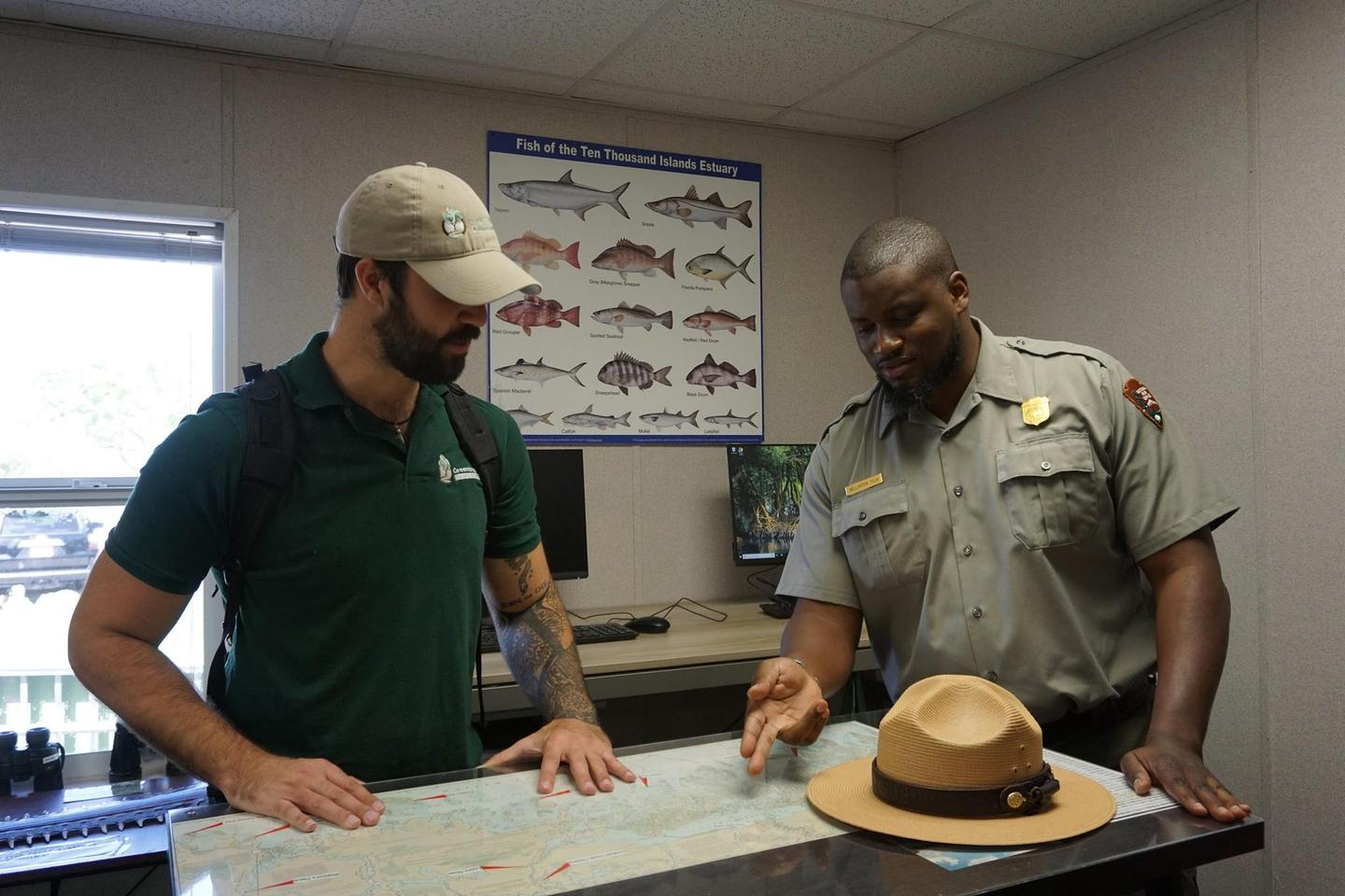 Visitor Center Information DeskA park ranger helps orient a visitor at the Gulf Coast Visitor Center information desk
