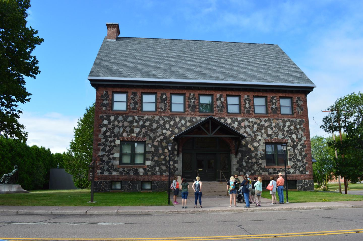 Keweenaw History CenterA ranger guided walk outside the former Calumet & Hecla Public Library, now known at the Keweenaw History Center.
