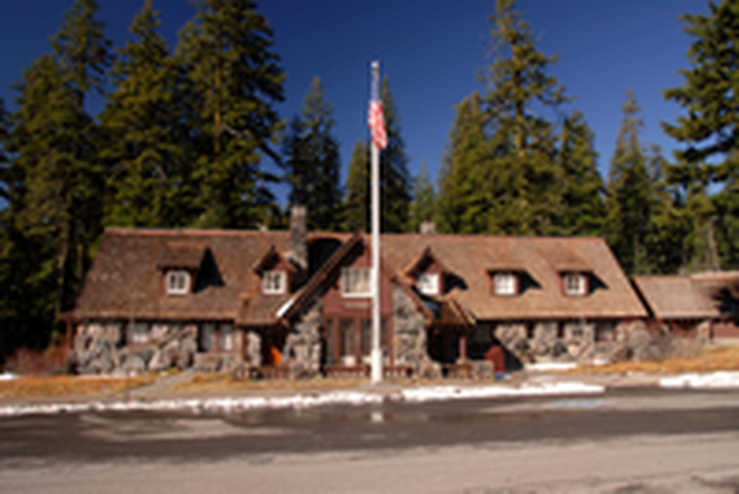 Steel Visitor CenterThe snow has melted, icicles no loner hang from the roof, the flag is flying, and the front door to the visitor center is open for summer visitors.