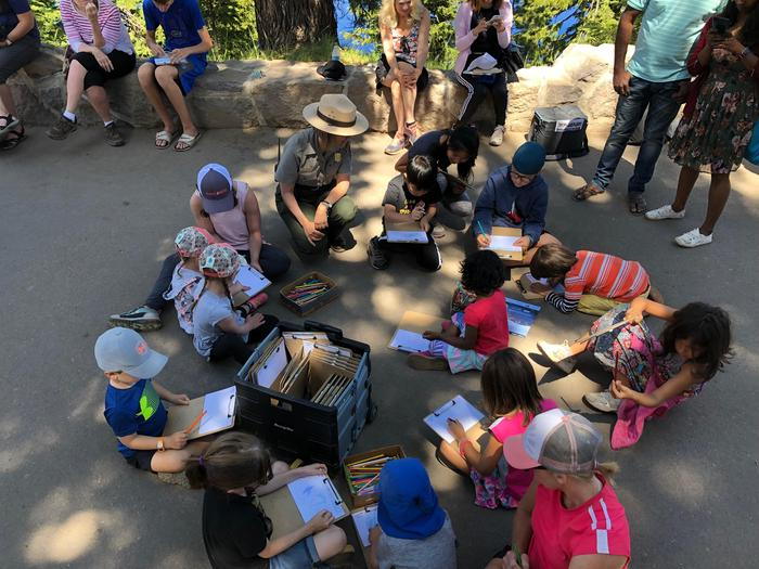 Junior Ranger Postcard ActivityA Junior Ranger Activity presented during the summer at Rim Visitor Center explores art and its relationship to the park. Children are designing postcards. This and other activities are funded by the Crater Lake Natural History Association.