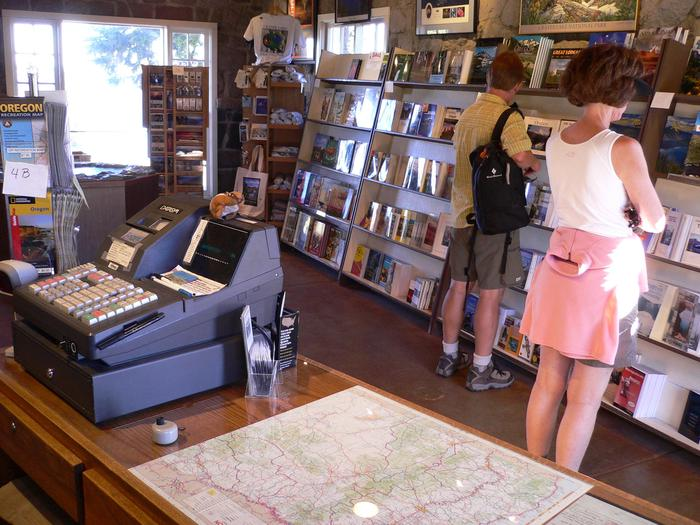 Crater Lake Natural History Association Park StoreVisitors peruse a variety of books and gifts on shelves in the Rim Visitor Center. Come take a look around.