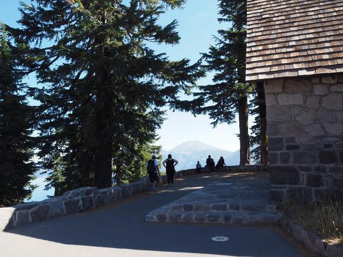 Rim Village Visitor Center Lake ViewThe stone wall defining the Rim Village Promenade, curves behind the Rim Visitor Center where visitors pause for the views.