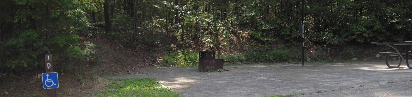 D001D001 is an accessible site located across from the bath house.  Tent pad is all asphalt and stakes cannot be used for tents.