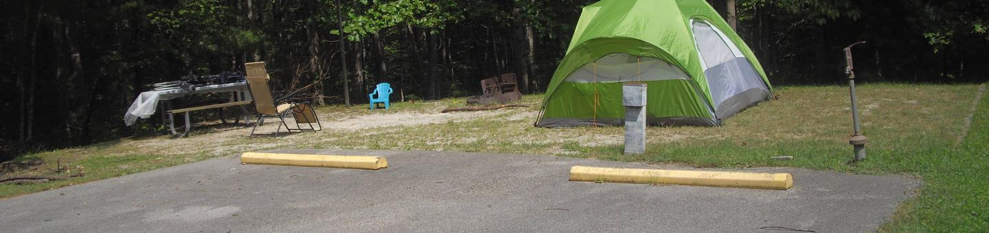 D023D023 is a double parking spot site in a cul-de-sac low traffic area.  Awning opens over a parking spot, best suited for a tent or pop up.  5 minute walk to bath house.