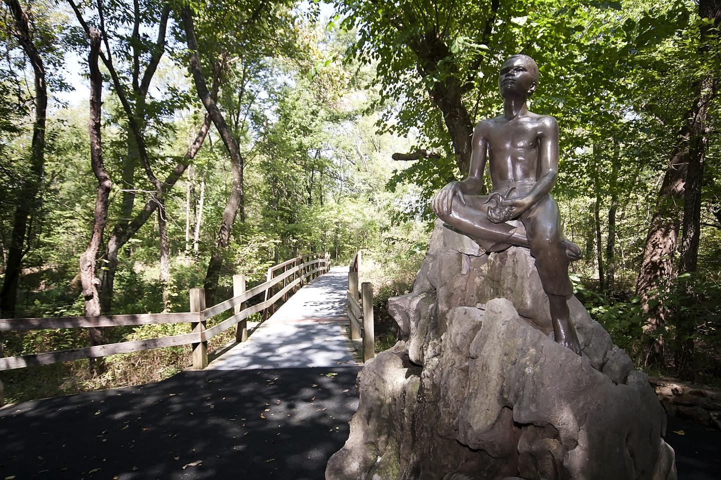 "Statue of young George Washington Carver on the Carver trail""Boy Carver Statue,"" sculpted by Robert Amendola in 1960."