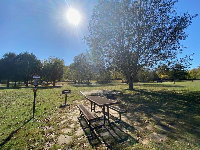"""Tyler Bend Campsite #7Site #7, 50"""" back-in, tent pad 15' x 15'. Parking area is wide enough for RV & car to park side by side."""