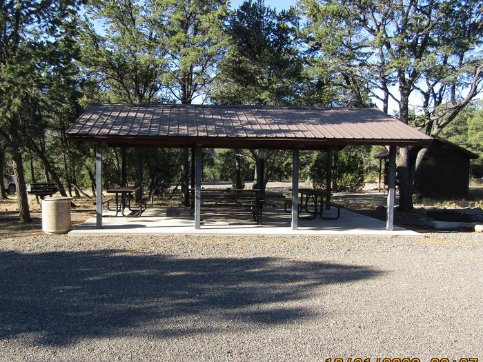 Accessible bathrooms and community picnic area. Group site A gathering area.