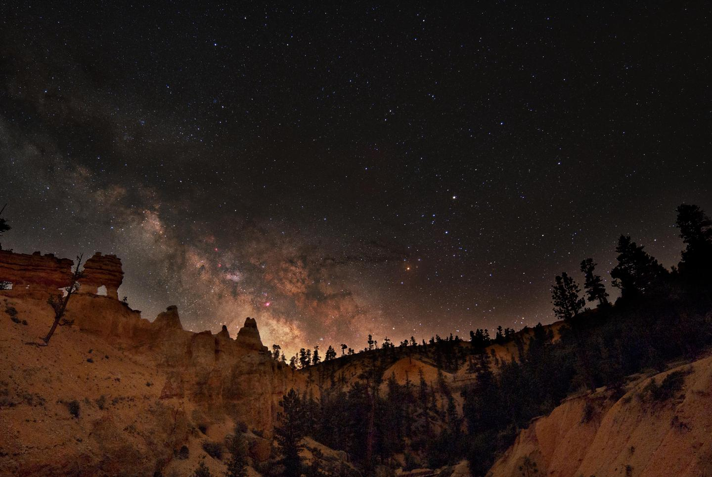 Milky Way over the HoodoosBryce Canyon's clean air and dark night skies are some of its most precious and vulnerable resources. Full moon nights also provide a unique experience of seeing the park after dark.