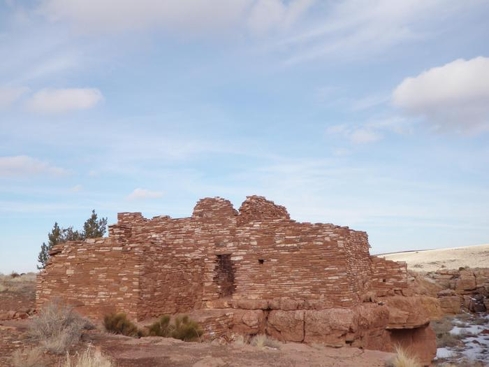 """Lomaki PuebloLomaki means """"beautiful house"""" in the Hopi language. The pueblo is located ten miles from the visitor center and is reachable via a short, 0.5 mile trail."""