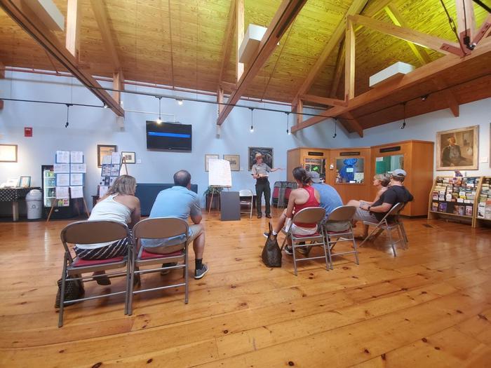 Presentation inside STGE Visitor CenterA Park Ranger gives a presentation inside the Visitor Center at Ste. Geneviève National Historical Park