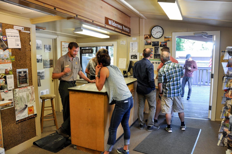Big Oak Flat Information Station help deskA ranger assists visitors at the Big Oak Flat Information Station help desk.