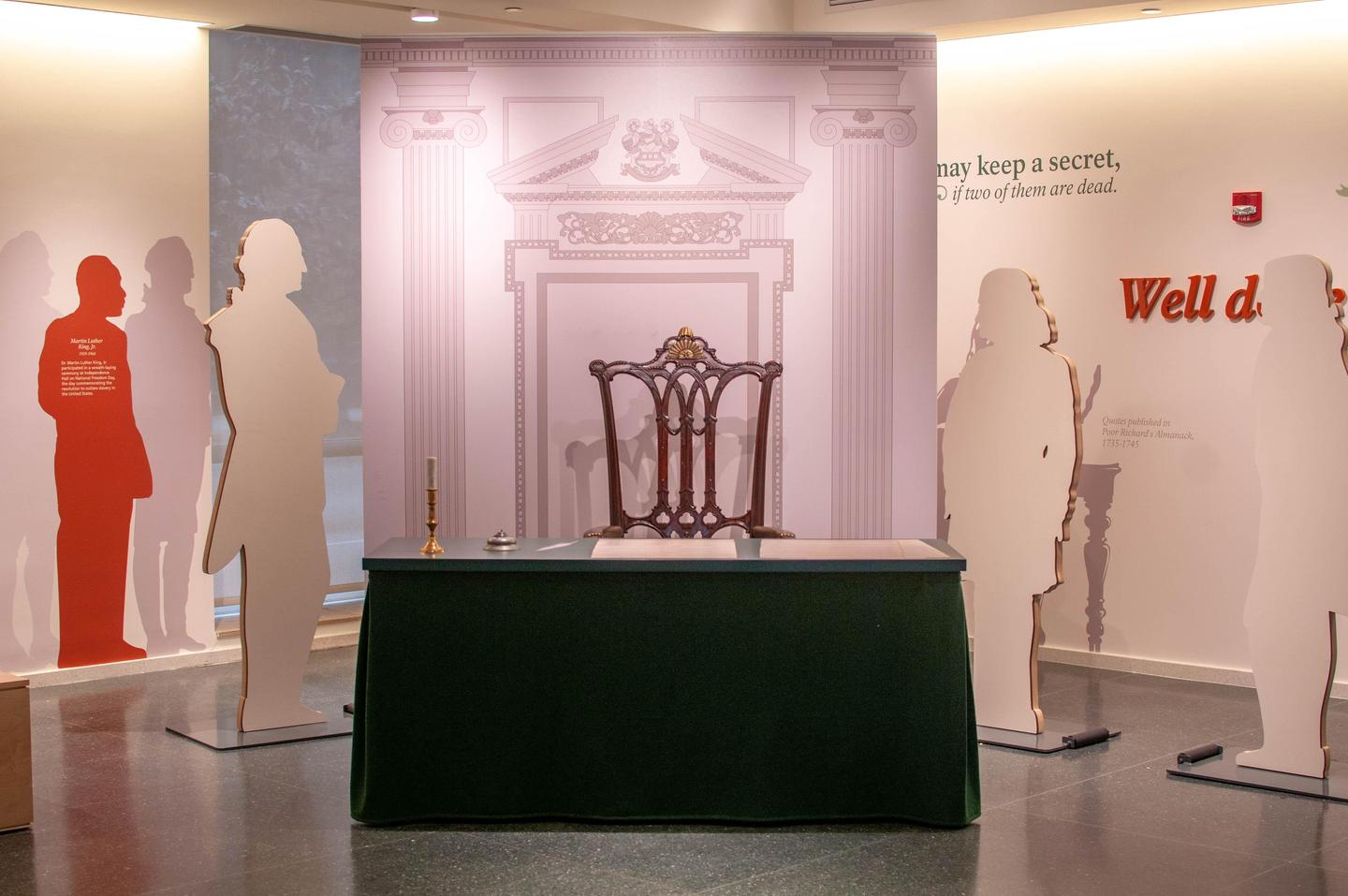 """Independence Visitor Center exhibit area, """"signing"""" stationDon't miss this opportunity to sit in a reproduction of the chair George Washington sat on when he presided over the Constitutional Convention. Photo alert!"""
